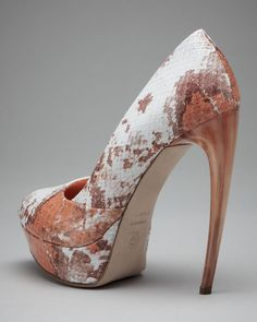 Horn heel Python pump.  This shoe is $1,850.00.   Alexander McQueen-you own my soul.