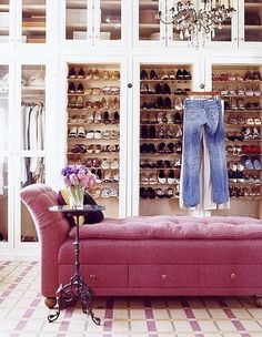 glass doors, pink chaise in the closet