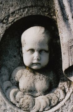 Don't Blink?  Near the center of Cedar Hill Cemetery is a large tombstone with a 3-D image of a baby's face carved on it. According to legend, if you stare at the baby's face for a while and then turn away, when you look back at the tombstone, the baby will be looking in a different direction. So make sure you take one last glance over your shoulder when you're walking away from this tombstone. Because you never know who, or what, might be watching you.