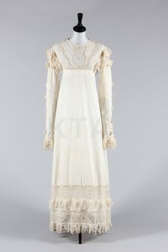 1815-1820 - Summer gown - Broderie anglaise; the empire-line bodice, skirt hem and sleeve sides trimmed and inset with cutwork lace, cotton tassels and tufts; together with a whitework sprigged cotton empire line skirt