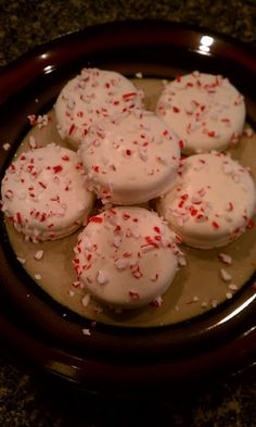 White chocolate dipped oreo cookies topped with peppermint bark