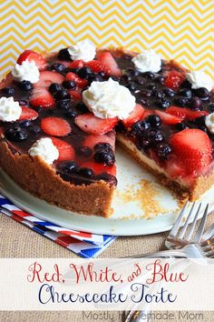 Red, White,  Blue Cheesecake Torte - A sweet graham cracker crust, creamy cheesecake, and topped with a blueberries and strawberries - the perfect no-bake way to celebrate the 4th of July!