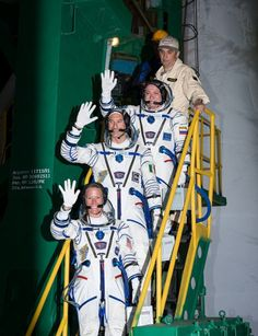 Expedition 36/37 Soyuz Commander Fyodor Yurchikhin of the Russian Federal Space Agency (Roscosmos), top, Flight Engineers: Luca Parmitano of the European Space Agency, center, and Karen Nyberg of NASA, bottom, wave farewell as they board the Soyuz rocket ahead of their launch to the International Space Station, Wednesday, May 29, 2013, Baikonur, Kazakhstan. Credit: NASA/Bill Ingalls.