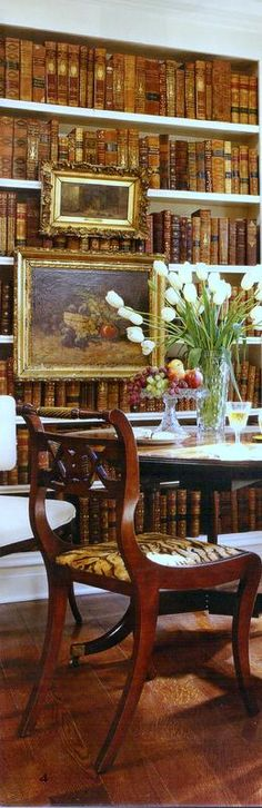 A breakfast room with a bookcase.