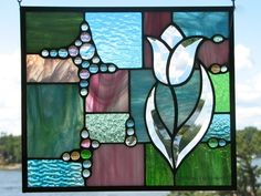 Patchwork stained glass panel with bevel tulip by Barbara's Glassworks