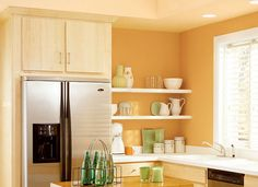 Small, bright kitchen. I like the light wood cabinets as well as the yellow & whit combo...