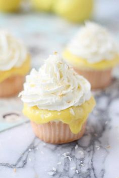 LUSCIOUS Coconut Cupcakes with Lemon Curd, Vanilla Whipped Cream and Toasted Coconut.