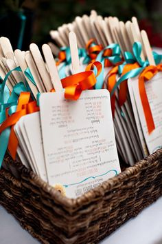Program fans with teal and orange ribbon. Photography by ashleightaylorphotography.com, Wedding Planning by lafeteweddings.com