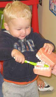 Toddler tooth brushing...
