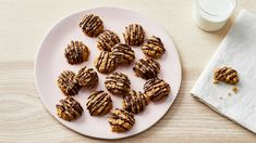 Protein-packed natural peanut butter and oats form the base of these chewy retro treats drizzled with dark chocolate. They're delicious, gluten-free, and best of all, super easy to make.
