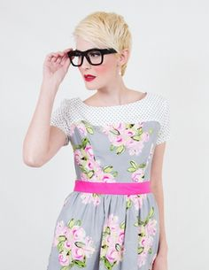 Thick black glasses with blonde pixie cut. So cute!