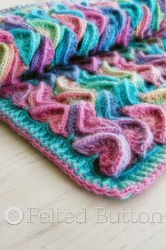 Look at that crochet stitch!  Sea Song Blanket Crochet Pattern by Felted Button