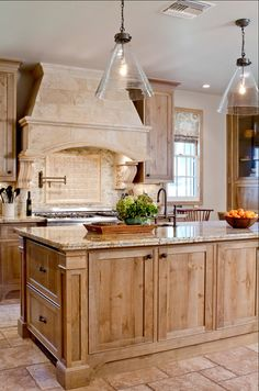 """Granite is called """"Carmel Gold"""".  The hood is a """"Travertine kitchen hood"""" from a company called """"Materials Marketing"""".  The cabinets are..."""