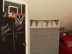 Chalkboard painted door with the basketball hoop on it