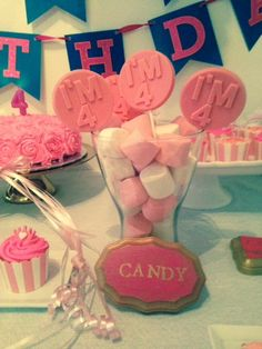 Pink marshmallow and lollipop centerpiece at a Princess Birthday Party!  See more party ideas at CatchMyParty.com!
