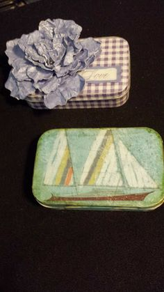 Altoid tins covered with CTMH papers. Boat and Flower.