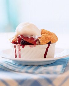 Fresh peaches and blueberries are sugared, spiced with cinnamon, and then topped with cobbler crust and baked until golden brown.