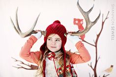 Whimsical Holiday Photo idea - Antlers - It looks like she's outside in the snow, but look at the owl and bird in the background.  I think it's a backdrop!