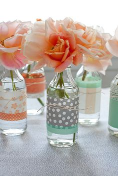 @Madilyn Grimm  look what i found. its even kind of your color. i think. if i can remember.  Wrap clear bottles or jars w/scrapbook papers & tied with raffia....simple elegance