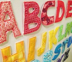 fabric magnetic letters--love these! I could totally make these!!!...first awesome project!! :D