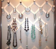DIY Jewelery Organizer Tutorial : use expandable peg hooks to keep jewelery organized... rings on top, bangles & bracelets in the middle, and necklaces on the bottom rows.  Could be painted and look so cute.