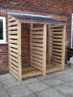 Corrugated steel or pvc over woodpile! Firewood store- or could be bare bones for garden shed ...
