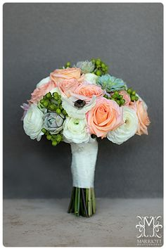 Bridal Bouquet: Hand tied bouquet featuring green succulents, white anemone, white ranunculus, green hypericum berries, peach roses,blush dahlias wrapped in lace ribbon