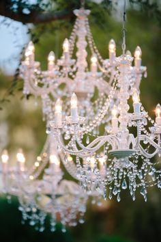 Chandelier lit ceremony | Read More: http://www.stylemepretty.com/little-black-book-blog/2014/06/25/modern-elegant-wedding-at-miramonte-resort-spa/ | Photography: Heather Kincaid - heatherkincaid.com