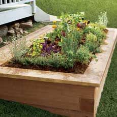 Nice looking, low cost flower bed or raised garden. 3 x 5 x 8 Pressure Treated Landscape Timber only cost $ 1.97 at Home Depot. I'll use this basic design for inspiration of a raise flowerbed in my front yard. I like the capped top and for a final touch I'll stain the wood.