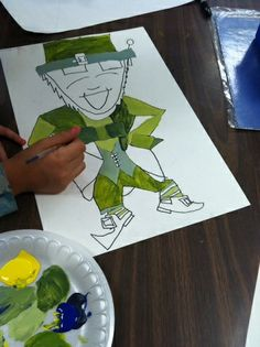 "Use my ""How-to draw a Leprechaun"" handout to create a fun looking leprechaun. Then teach your students about monochromatic color schemes (one color). Using tints, shades, and other variations of green your students will create unique, beautiful paintings. They LOVE mixing paint so this is a winning project every time!"
