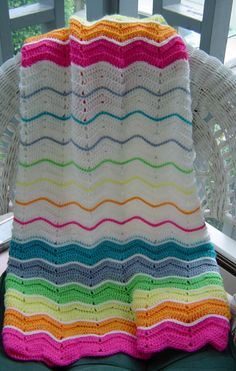 Fun with color! Rainbow & white ripple. http://croknit.blogspot.com/2007/10/ripple-baby-blanket.html