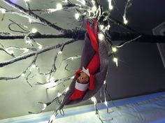 Elf on the shelf relaxing: use dish rag and tie onto tree:) place elf on the shelf.
