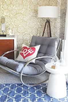 emily henderson styled oh joy's place. great wallpaper, great chair, great throw pillow.