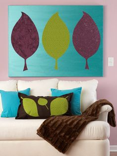 leaf silhouettes in fabric, glued on to large painted or fabric covered canvas.