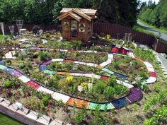 I've been trying to figure out how to plan my huge garden, this is a great idea! Life size board game in children's garden