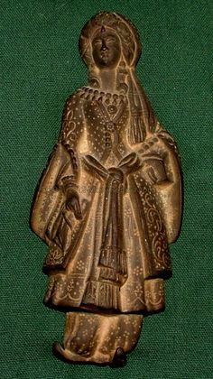 This is an ornate cast iron lady about 6 inches tall.  Dug up on the grounds of Moran Place many years ago.