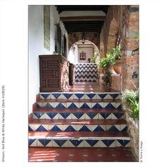 Chevron-patterned Mexican tile risers  ---would be great in pool and steps to pool