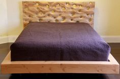 http://www.etsy.com/listing/96428676/sanddrift-platform-bed?ref=sr_gallery_9_search_query=upcycled_view_type=gallery_ship_to=US_min=0_max=0_search_type=handmade  This awesome bed costs $2,300! It is made from reclaimed douglas fir and hemlock. You can see the grains of the wood on the headboard and the bubbles make it look stylish and contemporary!