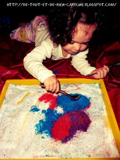 Drawing with colored sugar on white sugar: Safe for toddlers and lots of fun!