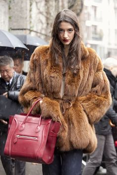 Street Chic Straight From Milan Fashion Week: a fur, and with a Céline tote in tow.