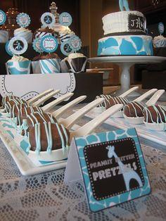 Safari baby shower dessert table with cake