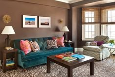 I love the rich color palette in this living room by Annsley Interiors. How fabulous is the peacock blue, tufted velvet sofa?