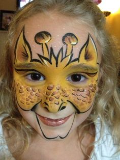 Giraffe face paint. Zoo Party and Safari Party fun!