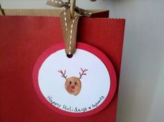 Reindeer fingerprint gift tags...and they can double as an ornament!
