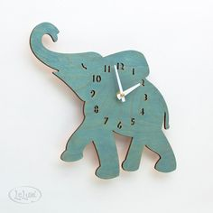 """The """"Baby Turquoise / Teal Elephant"""" designer wall mounted clock from LeLuni. $52.00, via Etsy."""