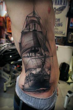 wicked awesome side tattoo of a ship.