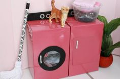 the cutest little laundry room out of household items! has links to video tutorials.