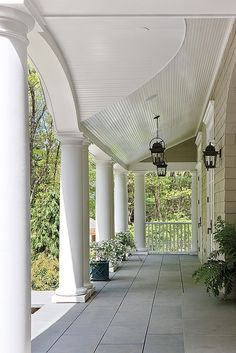 I love a front porch, it reminds me of southern style homes, so pretty