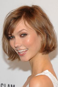 Karlie Kloss keeps it fresh and natural with a rosy-beige gloss thats just a tad darker than her natural lip hue.