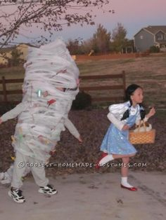 A kid dressed up as a tornado chasing a kid dressed up as Dorothy - seriously... How hilarious is this?!